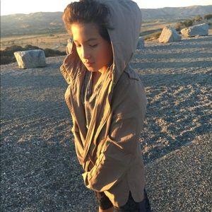 tan jacket wit a hoodie
